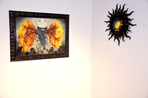 My painting Second Breath has a crush on Sam Stone's intriguing Black Splash Mirror!